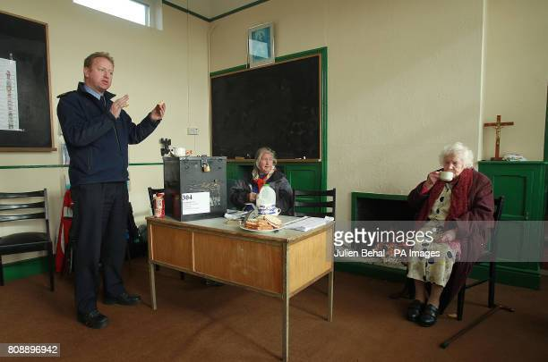 Garda Martin Reilly from Achill chats with islanders and voters Annie Calvey and Bridgie O'Malley over tea and sandwiches in the polling station in...