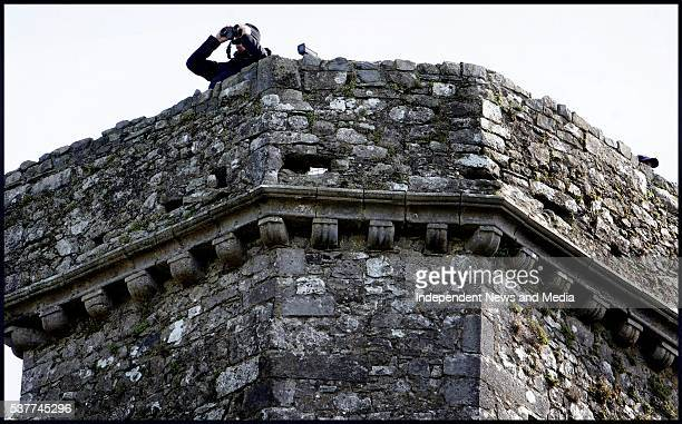 A Garda officer provides security for the Queen's appearance at St Patrick's Rock during a state visit Cashel Ireland May 20 2011 The visit was Queen...