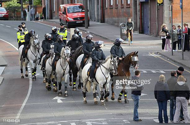 Garda on horseback form a protective ring around Dublin Castle as the Queen attends a state dinner on May 18 2011 in Dublin Ireland The Duke and...