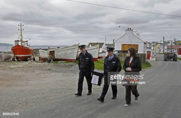 Garda Patrick McGynn Sergent Gerry Lee and electoral officer Claire Sharkey delivering ballot boxes to Tory Island off the Co Donegal coast as...