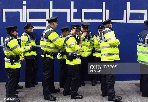 Garda police officers queue up to enter a nightclub in the Temple Bar area of Dublin on May 17 2011 in Dublin Ireland The visit by Queen Elizabeth II...