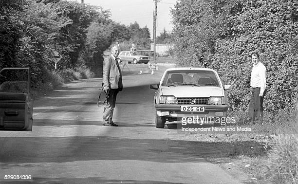 Gardai examine one of the getaway cars abandoned on the Ashbourne road outside Dunshaughlin which was used in the raid on the Drumree Co Meath Post...
