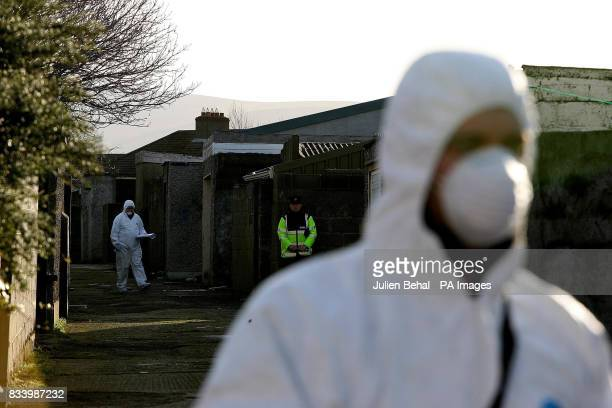 Gardai forensic officers at the scene of last night's fatal stabbing in a laneway off Beechfield Road in the Walkinstown area of Dublin