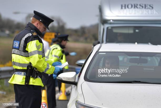 Gardai police officer mans a checkpoint on the border between the Republic of Ireland and Northern Ireland as they check for non essential travel...