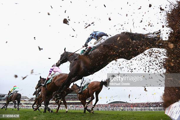 Garde La Victoire ridden by Richard Johnson clears a fence on the first lap of the Merseyrail Manifesto Novices' Steeplechase race at Aintree...