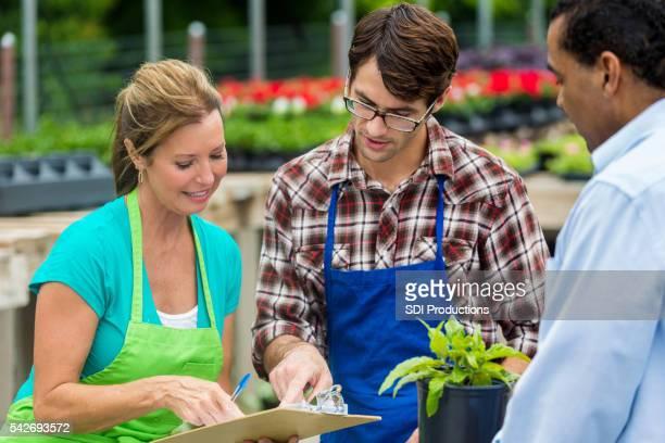 Garden center employees assist customer