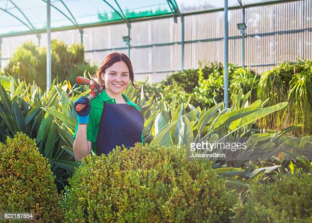 Garden center owner with shears