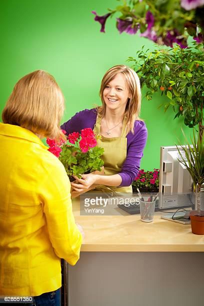 Garden Center Shop Owner Serving Customer in Retail Store