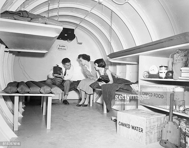 HBomb Hideaway Snug as a bug in a rug a family can sustain itself for three to five days after an HBomb blast in this buried tank shelter called a...