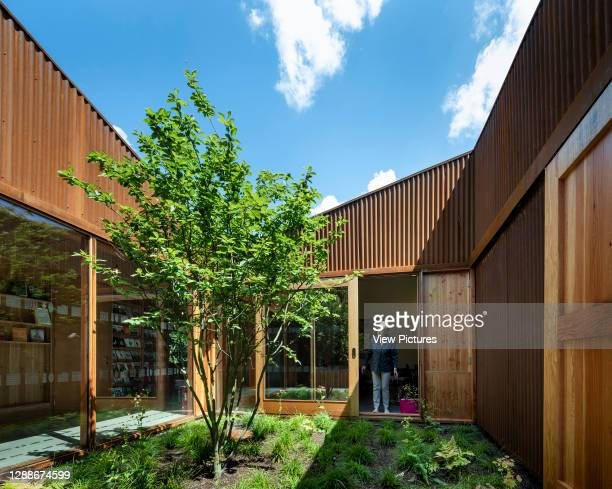 Garden courtyard. Maggie's Centre at Velindre Hospital, Cardiff, United Kingdom. Architect: Dow Jones Architects, 2019.