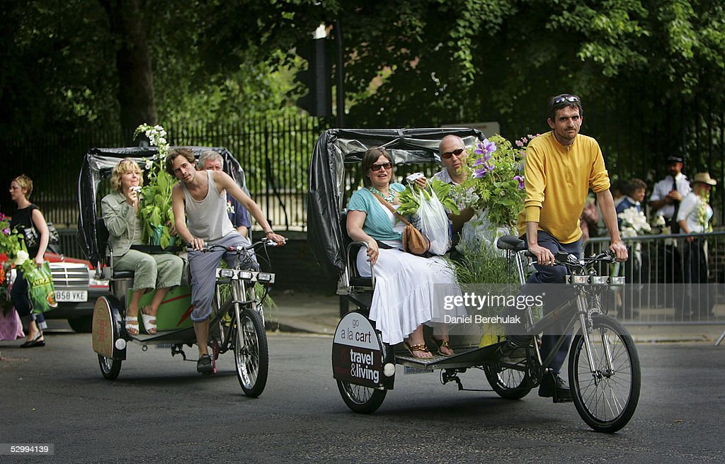 Garden enthusiasts catch rickshaws to transport their purchases home during the last day of the Royal Horticultural Society's Chelsea Flower Show on May 28, 2005 in London, England.