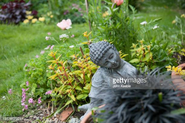 garden exteriors - sculpture stock pictures, royalty-free photos & images