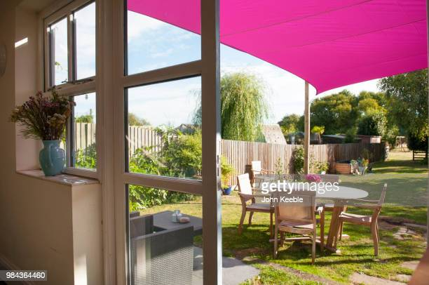 garden furniture set in the garden on a sunny day - gras stock pictures, royalty-free photos & images