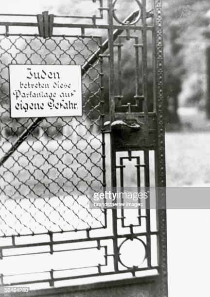 Garden gate with antiSemitic instructions Jewish people enter garden gate at their own risk Photography about 1937 [Parktor mit antisemitischem...