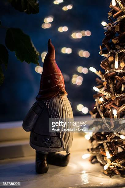 garden gnome and christmas tree - gnome stock pictures, royalty-free photos & images