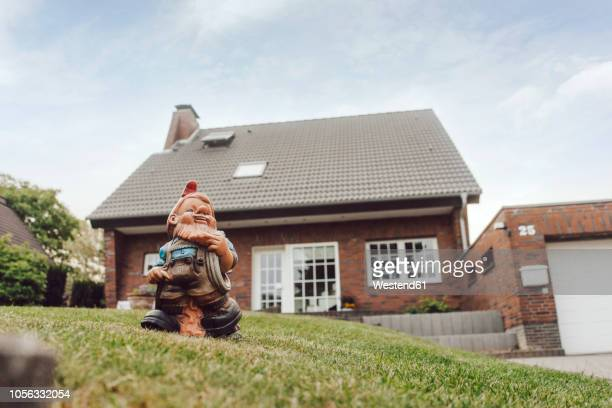 Garden gnome in garden of one-family house
