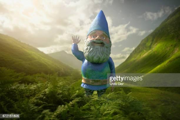 garden gnome in lush green valley - garden gnome stock photos and pictures