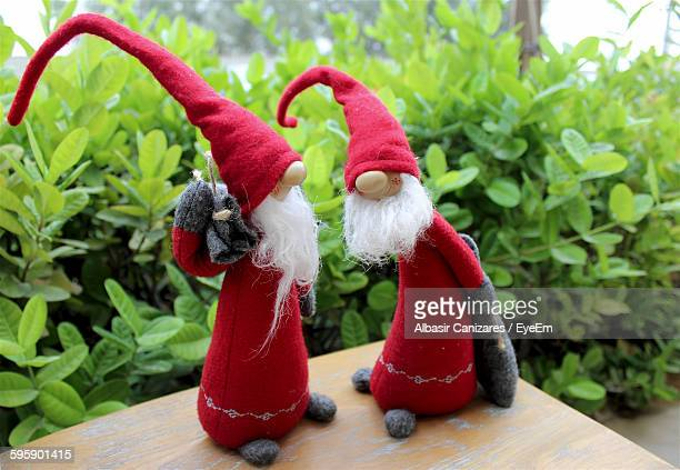 garden gnome on table during christmas - gnome stock pictures, royalty-free photos & images