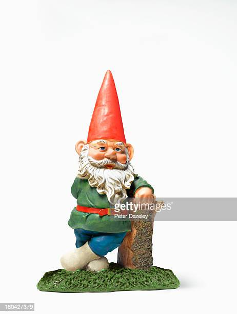 Garden gnome relaxing with copy space