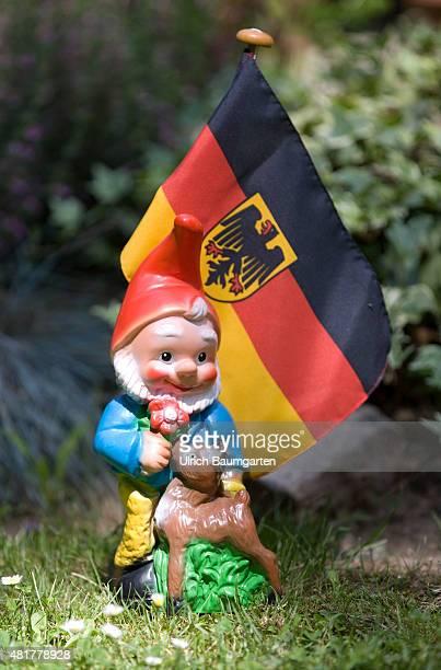 Garden gnome with a German flag in a front garden