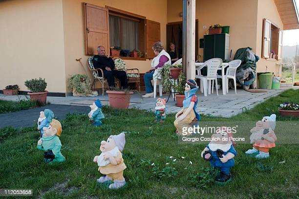 Garden gnomes representing the characters Snow White and the Seven Dwarfs stand on a lawn in front of a dwelling in the temporary housing area near...