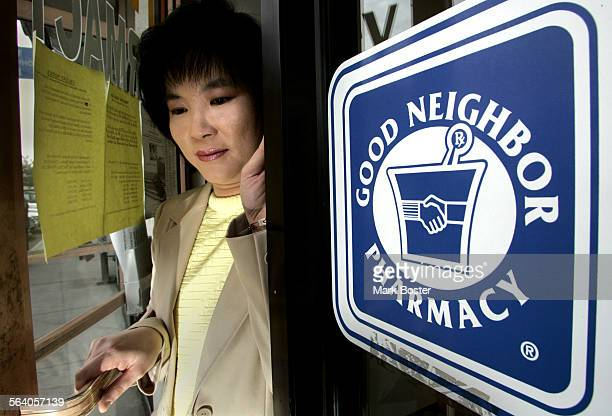 –Garden Grove Pharmacist Thu–Hang Tran stands in the doorway of her pharmacy that is closed Tran store is one of about 50 independent pharmacies in...