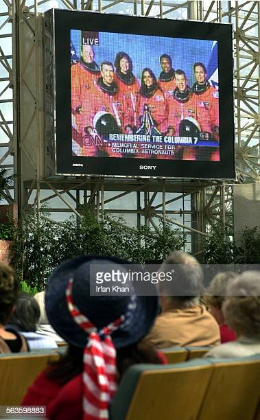 Garden Grove, Tuesday, Feb. 04, 2003 –––– Parishioners at Crystal Cathedral watch live broadcast of memorial service from Houston for the crew of...