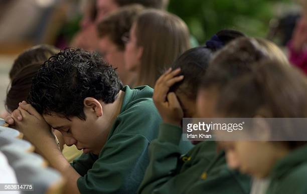 Garden Grove, Tuesday, Feb. 04, 2003 –––– Students from Crystal Cathedral High School pray at a memorial service held at Crystal Cathedral for the...