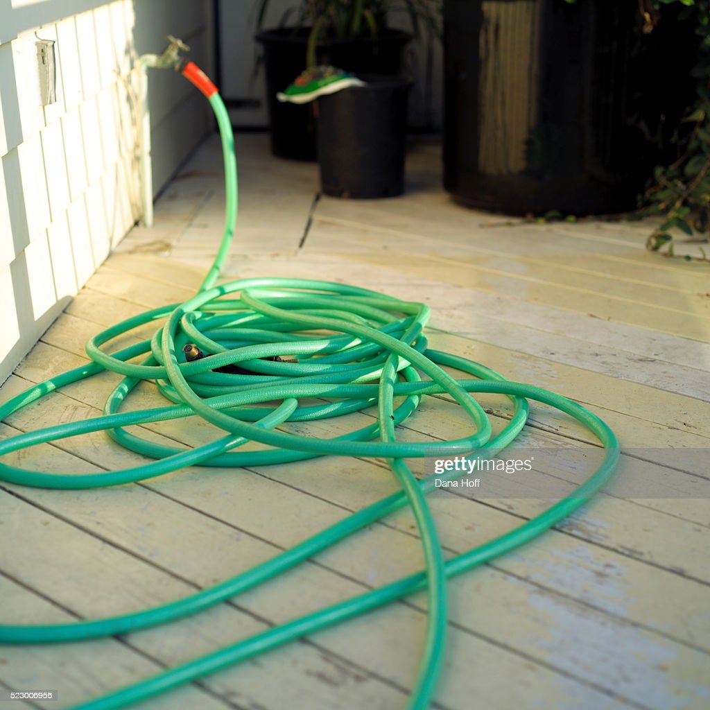Garden Hose On Wood Deck : Stock Photo