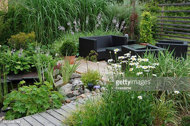 garden lounge - gras stock pictures, royalty-free photos & images