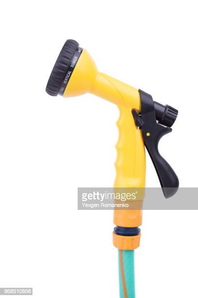 Garden nozzle Sprayer with adjustable water jet on a hose. Convenient sprayer for variable watering and cleaning tasks, isolated on white background