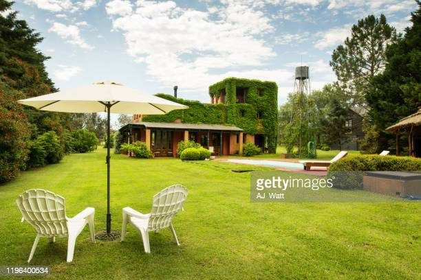 garden parasol with chairs - parasol stock pictures, royalty-free photos & images