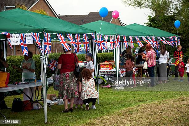 garden party, gazebos, flags and bunting - fete stock photos and pictures