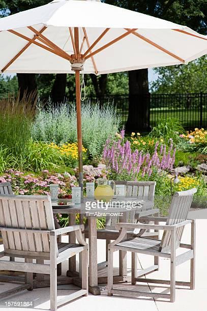A garden patio with big white umbrella