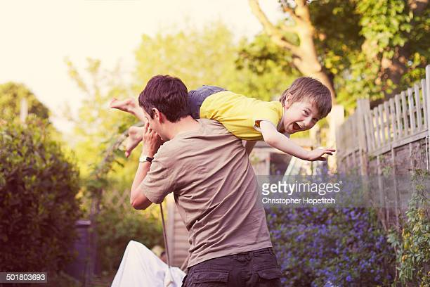 garden play time - carrying stock pictures, royalty-free photos & images