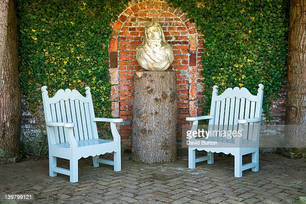 garden seats and bust on tree trunk plinth, houghton hall, norfolk, england - sculpture stock pictures, royalty-free photos & images