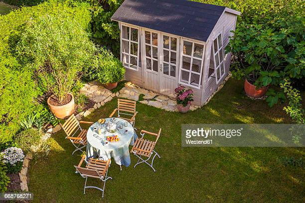 garden shed and laid table in garden - shack stock pictures, royalty-free photos & images
