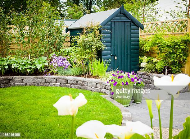 garden shed in a beautiful green garden - shed stock pictures, royalty-free photos & images