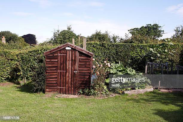 garden shed in typical english back yard - shack stock pictures, royalty-free photos & images