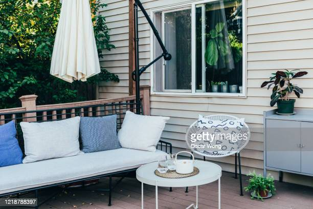 garden sofa and cushions in the back yard - domestic garden stock pictures, royalty-free photos & images