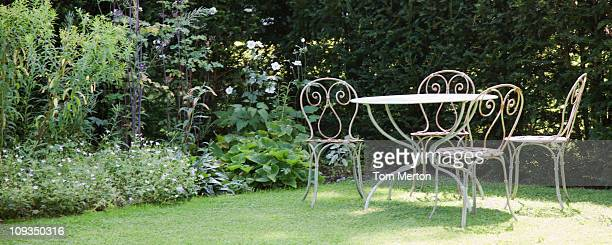 garden table and chairs in backyard - furniture stock pictures, royalty-free photos & images