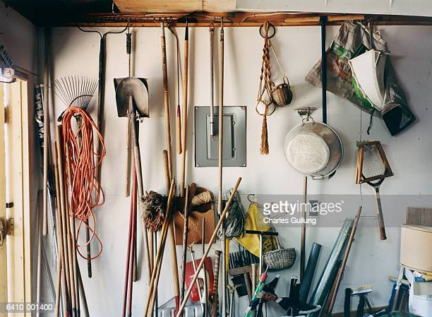 garden tools in garage - gardening equipment stock pictures, royalty-free photos & images