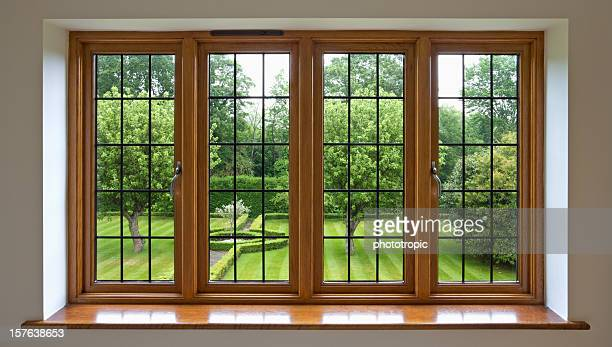 garden view through leaded glass window - window frame stock pictures, royalty-free photos & images