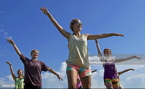 """Gardendale """"Rockettes"""" Faith Stancil, Sarah Rogers, Hannah Harris and Anna Grace Dabbs practice with the marching band before school begins next week..."""
