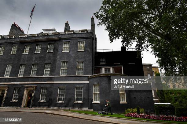 Gardener cuts the grass in Downing Street on June 7, 2019 in London, England. Today is Theresa May's last day as Conservative Party leader, however...