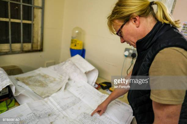 Gardener Karen Greenwood checks the design plans at Mount Grace Priory ahead of a media event to launch a new arts and craft style garden created by...