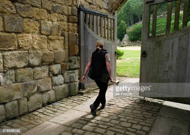 Gardener Karen Greenwood walks through the entrance to Mount Grace Priory ahead of a media event to launch a new arts and craft style garden created...