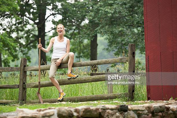 Gardener sitting on wooden fence
