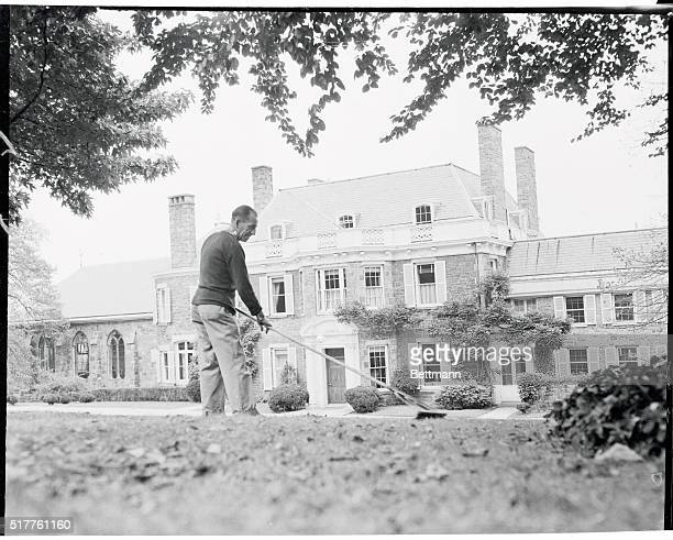 A gardener tidies up the grounds of Waves Hill a 124 year old Georgian home overlooking the Hudson River in preparation for the visit of Queen Mother...