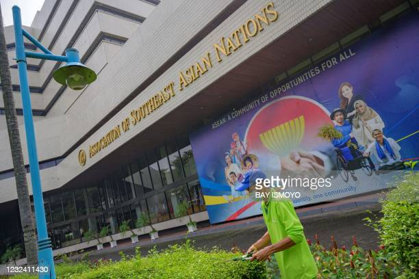 Gardener trims plants in the courtyard of the Association of Southeast Asian Nations secretariat building in Jakarta on April 20 ahead of the ASEAN...
